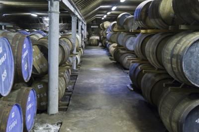 Whisky Barrels Maturing in a Local Scotland Distillery