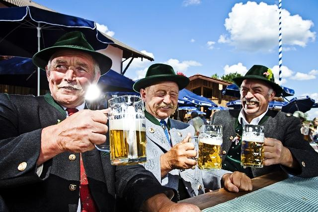 Locals enjoying a brew in traditional Bavarian garb.